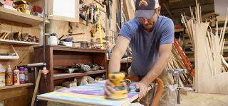 man making wooden prop