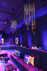 couch area of neon themed party room