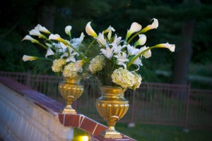 flowers in large golden vases