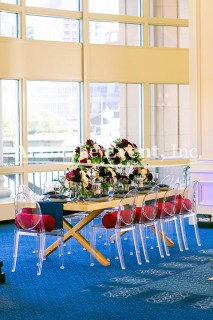 zoom out shot of full table setting with floral centerpieces