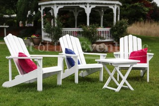 white Adirondack chairs with colorful pillows