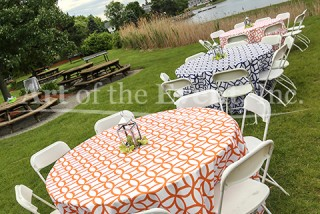 Round Tables with Blue and Orange tablecloths