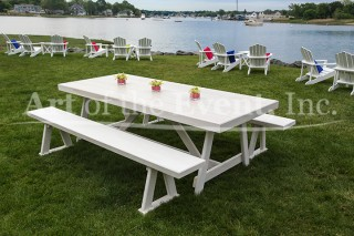 white picnic table along the water