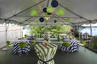 tented area with tables and decorations