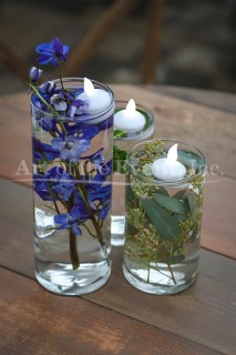 Tall Vases filled with water and flowers