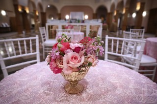 pink flowers in a gold vase