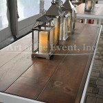 wooden table with lanterns on top