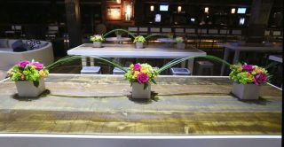 floral displays on wooden table