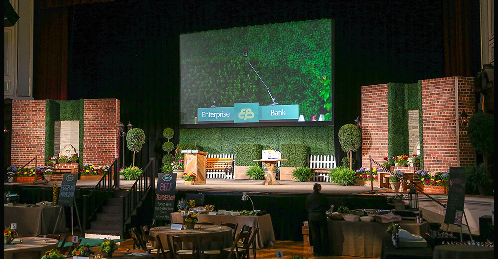 Stage with brick props and fake plants