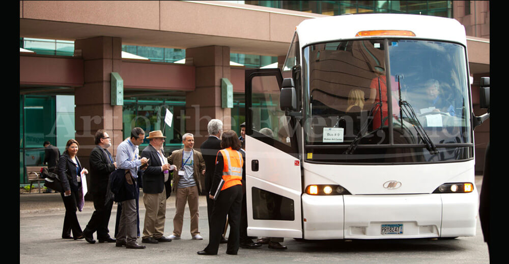 people boarding coach bus