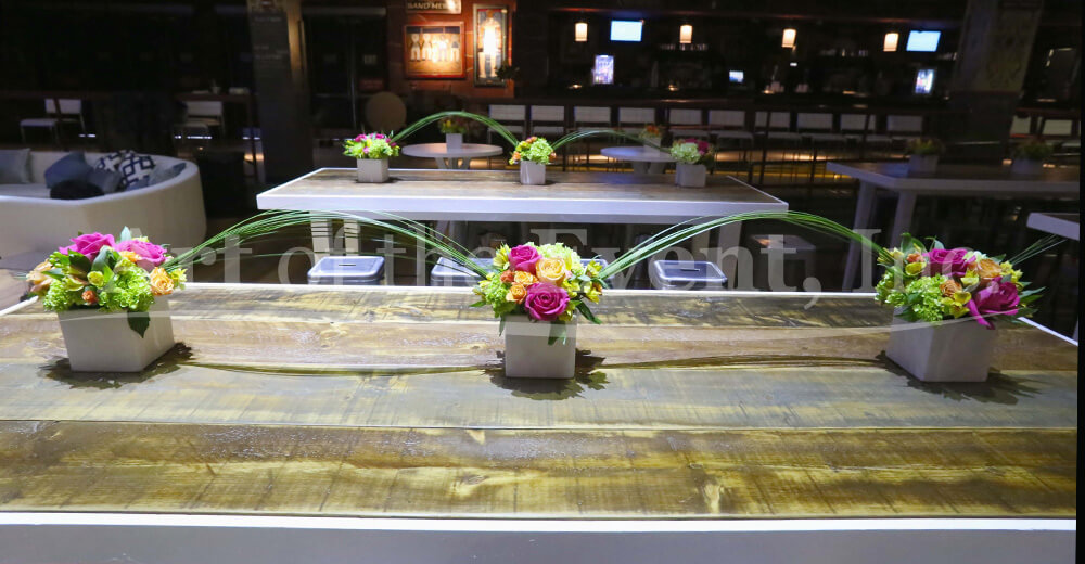 Small floral displays on wood table
