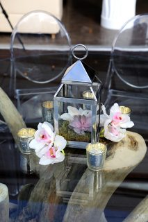 Floral and candle table centerpieces