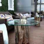 glass-topped table with driftwood legs