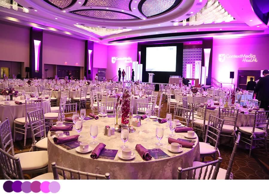 Large purple-themed dinner event