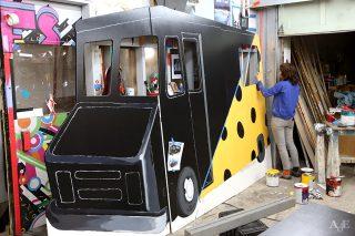 Painting cardboard bus display