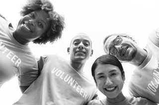 black and white photo of group of volunteers