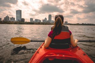 Female kayak-er on Boston's Charles River