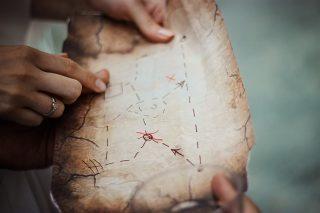 woman holding treasure map