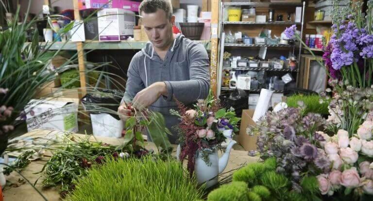 Man assembling flowers